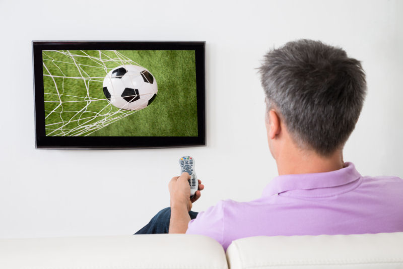 15316558-man-watching-soccer-game-on-television800